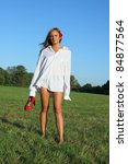 Young sexy woman walking on the grass - stock photo