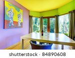 Purple, yellow and green furnished and colored living room - stock photo