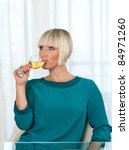 attractive woman drinks white wine - stock photo