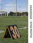 Thirty yard line marker on football field - stock photo