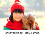 girl hold small dog in hands - stock photo