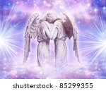 two  angels with rays of light over blue sky with stars - stock photo