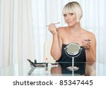attractive woman with make up set at her home - stock photo