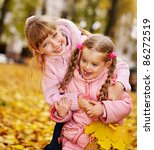 Children in autumn orange leaves. Outdoor. - stock photo