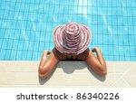 Closeup portrait of woman enjoying sun in swimming pool - stock photo