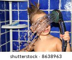Kid in a shower - stock photo