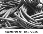 full frame detail of a old dusty audio cable entanglement - stock photo