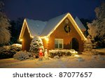 Snow covered cottage - stock photo