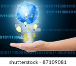 businessman hand with email, bulb light, dollar and world. - stock photo