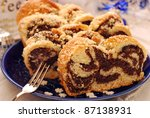 slices of rolled poppy cake for christmas - stock photo