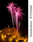 """Mausoleum of Hadrian, usually known as the Castel Sant'Angelo, during """"The Windmill"""", with the traditional fireworks show staged on the occasion of the Feast of Saints Peter and Paul on 29 June. - stock photo"""
