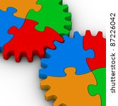 two gears of colorful jigsaw puzzles on white background - stock photo