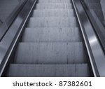 detail photography showing some moving stairs in reflective ambiance - stock photo