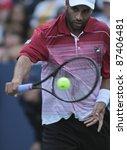 NEW YORK - SEPTEMBER 02: James Blake of USA returns ball during 2nd round match against David Ferrer of Spain at USTA Billie Jean King National Tennis Center on September 02, 2011 in New York City - stock photo