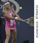 NEW YORK - SEPTEMBER 02: Maria Kirilenko of Russia returns ball during 3rd round match against Christina McHale of USA at US Open on September 02, 2011 in New York City. - stock photo