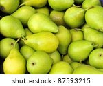 Green pears at a famers market in France - stock photo