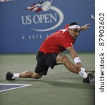 NEW YORK - AUGUST 31: Marcos Baghdatis of Cyprus returns ball during 1st round match against John Isner of USA at USTA Billie Jean King National Tennis Center on August 31, 2011 in New York City. - stock photo