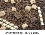 Chocolate pieces and coffee beans for background - stock photo