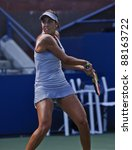 NEW YORK - AUGUST 29: Madison Keys of USA returns ball during 1st round match against Jill Graybas of USA at USTA Billie Jean King National Tennis Center on August 29, 2011 in NYC - stock photo