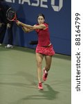 NEW YORK - AUGUST 29: Christina McHale of USA returns ball during 1st round match against Aleksandra Wozniak of Canada at USTA Billie Jean King National Tennis Center on August 29, 2011 in NYC - stock photo