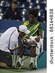 NEW YORK - AUGUST 29: Gael Monfils of France receives medial help during 1st round match against Grigor Dimitrov of Bulgaria at USTA Billie Jean King National Tennis Center on August 29, 2011 in NYC - stock photo