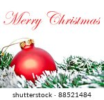 Red Christmas ornament ball with wreath isolated on white - stock photo