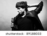 Fashion portrait of the young beautiful man - stock photo