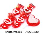 Red heart shape lolly pops isolated on white background. - stock photo