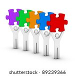 five men with multicolor jigsaw puzzles - stock photo