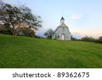 St. Joseph's Church. Maui.  Built in 1862 used to serve a large Hawaiian population. The walls of the old church stand near the new building. - stock photo