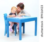 Young mother and her child spent time together. - stock photo