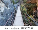 Rope bridge over a canyon in Cahorros, Granada, Andalusia, Spain - stock photo
