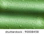 Many drops on green wavy background making texture - stock photo
