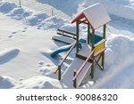 Kids playground in snowy winter scenery - stock photo