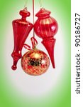 Christmas card. Red glass balls and cones on white with green vignette. - stock photo