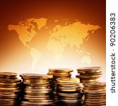 Coins stack on world map background. - stock photo