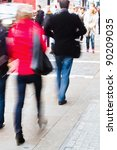 walking people on the sidewalk - stock photo