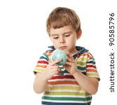 cheerful little boy looks at a globe. Isolated on white - stock photo