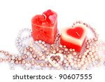 Heart shape red candles and necklaces isolated on white background. - stock photo