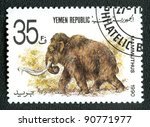 YEMEN REPUBLIC - CIRCA 1990: A stamp printed in Yemen shows Mammuthus, series devoted to prehistoric animals, circa 1990. - stock photo