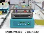 Laboratory test tube shaker - stock photo