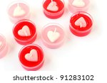 Heart shape red and pink candles  isolated on white background. - stock photo