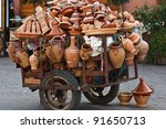 Pushcart loaded with clay wares pottery goods in the Marrakesh grand souk - stock photo