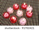 Red and pink candles on wooden math. - stock photo