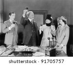 Four people toasting with wine - stock photo
