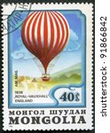 "MONGOLIA - CIRCA 1982: A stamp printed in Mongolia shows air-balloon ""Royal-Vauxhall"" 1836, series, circa 1982 - stock photo"