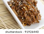 Beoseot Jorim - Korean side dish (banchan) of mushrooms simmered in soy sauce - Close-up - stock photo
