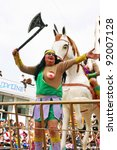 LIMASSOL,CYPRUS-MARCH 6, 2011: Unidentified people in amazonian costumes during the carnival parade, established in 16th century, influenced by Venetians. - stock photo