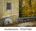 A historic colonial building with a millstone in Basto Village in Southern New Jersey. - stock photo