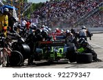 MILWAUKEE, WI - MAY 29: INDYCAR - crowded pit lane with crews working on cars during the race, May 29, 2009 in Milwaukee, WI. - stock photo